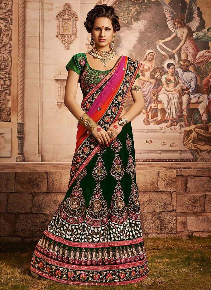 Shop this product from here.. http://www.silkmuseumsurat.in/green-stone-enhanced-velvet-lehenga-choli?filter_name=4631  Item:#4631  Color : Green Fabric : Velvet Occasion : Bridal, Party, Reception, Wedding Style : A Line Lehenga Work : Applique, Embroidered, Patch Border, Resham