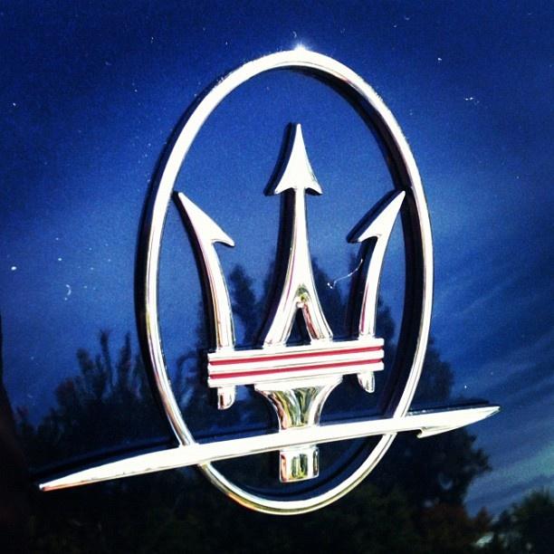 car with trident emblem