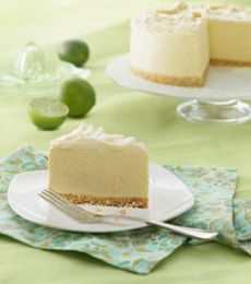 White #Chocolate Lime Angel Cheesecake - Light, sweet and instantly refreshing – this really is an angel #cheesecake. #baking To view the #CADBURY product featured in this recipe visit https://www.cadburykitchen.com.au/products/view/baking-block/