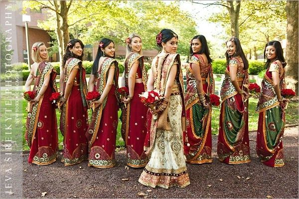 Indian bridesmaids in green and red sarees