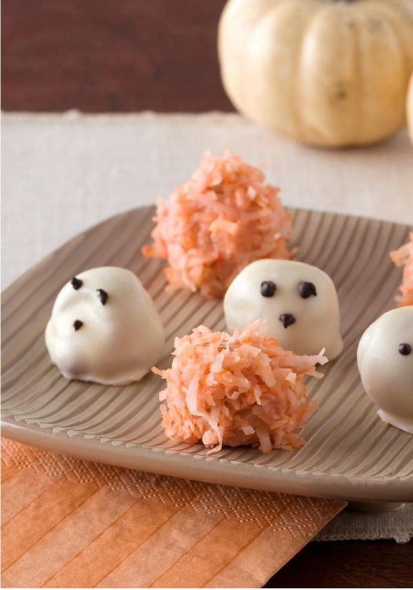 Easy Halloween Truffles -- File these easy Halloween desserts under ghoulishly delicious. These ghost truffles and pumpkins have chocolate centers that are a treat to bite into!