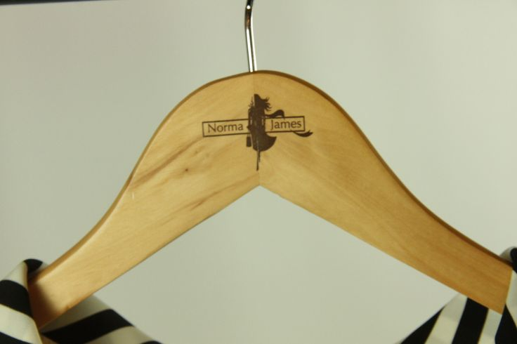 Norma James logo on one of our clothing hangers