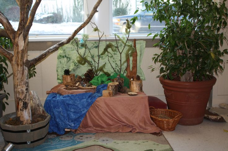 The Story Table - cut a big  floor plant up a little to make it look more like  a tree to utilize in stories and games.