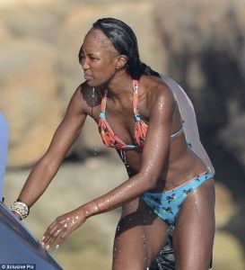 Naomi Campbell in bikini with bald hairline