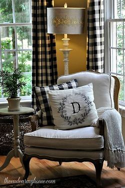 Black, white and gray French home design. The black and white check curtains are stunning.