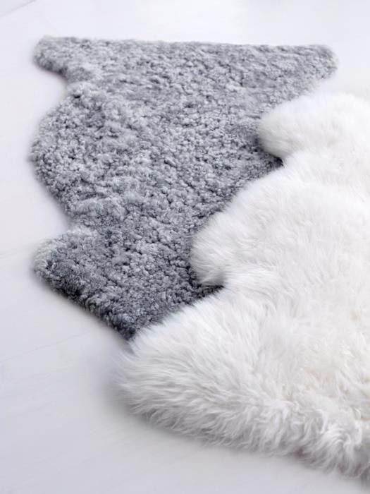 layer these sheepskins over new area rugs. create cozy. husband will love.  Via IKEA | Ludde Sheepskins