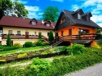 Spojrzenie na ognisko - ZAKWATEROWANIE na Słowacji - domki Aquatherm