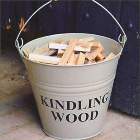 Quaint kidling wood bucket.  http://www.worldstores.co.uk/p/Inglenook_Cream_Kindling_Bucket.htm