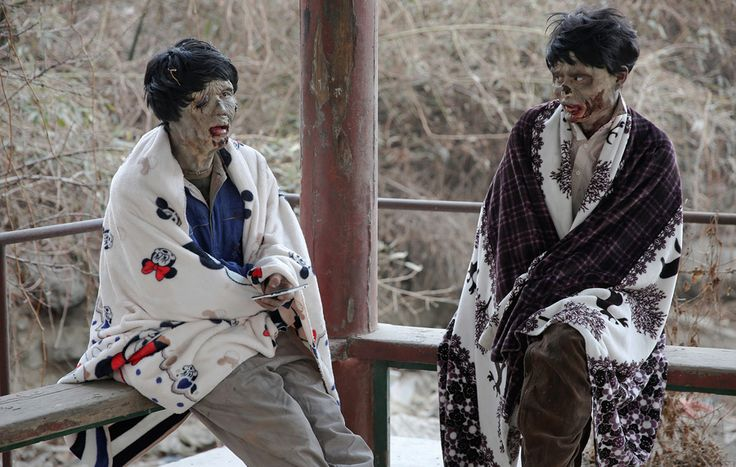 Actors wrapped in blankets react at the set of the post-apocalyptic movie Zombie Era at an abandoned factory complex in Langfang, Hebei province, China, on December 16, 2016. The Atlantic