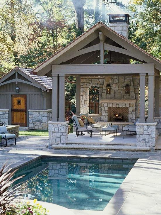 outdoor living space features small pool pool house covered patio with fireplace and interesting architectural features