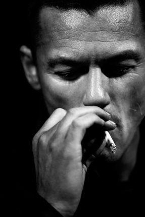 Luke Evans smoking a cigarette (or weed)