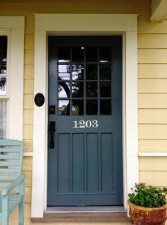 Blue grey door, yellow siding