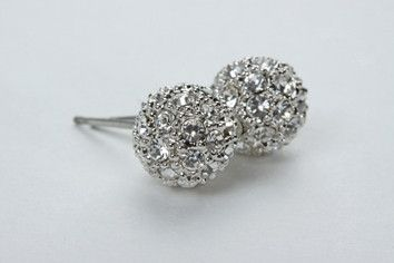 Pave Ball Earrings: These feminine earrings with vintage flair are sure to add loveliness to the look. 8mm balls encrusted with Swarovski crystals to give a pave finish. Real rhodium electroplated over brass. $79.90