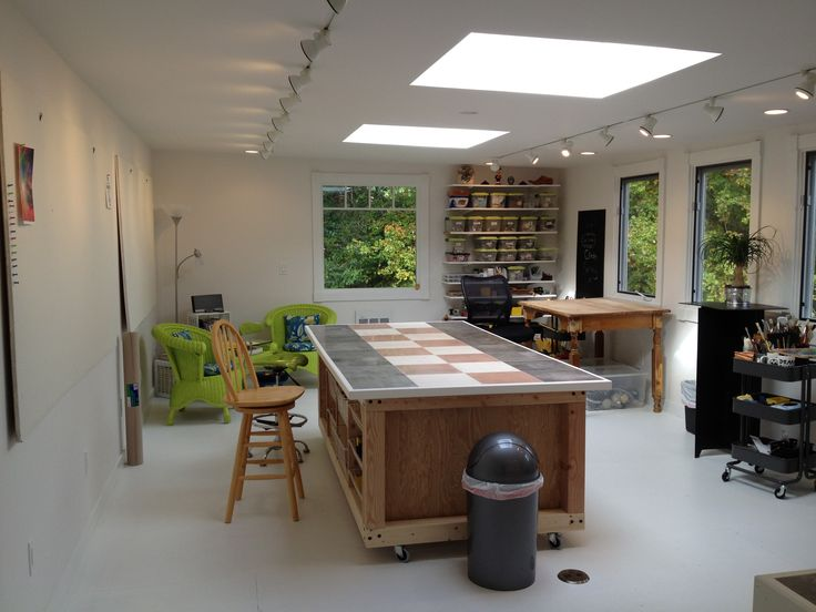 We had a storage room above our garage converted into my new art studio. We added 2 skylights, more windows and lots of recessed and track lighting.