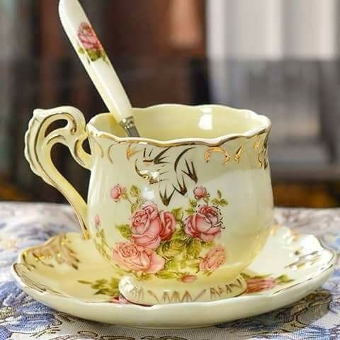 Tea cup, yellow decorated with painted pink rosese and gold