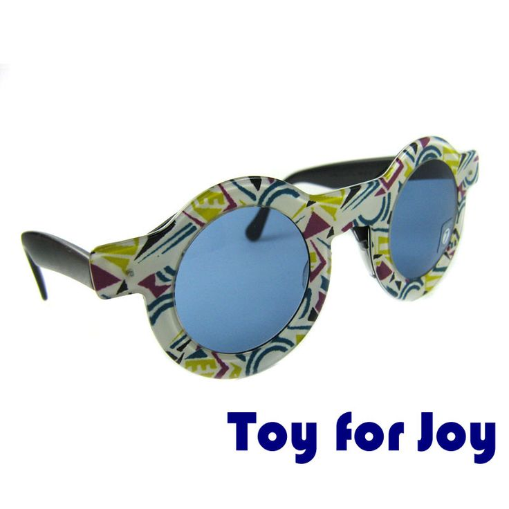 "Vintage sunglasses TOY FOR JOY SWATCH These round sunglasses are original and were made by Swatch in 1990s. The model ""Toy for Joy"" has a light-colored frame with abstract design reminding ethnic pattern. The lenses are blue round. The glasses are made of high quality acetate. The mask can be removed.  Price: €9.99"