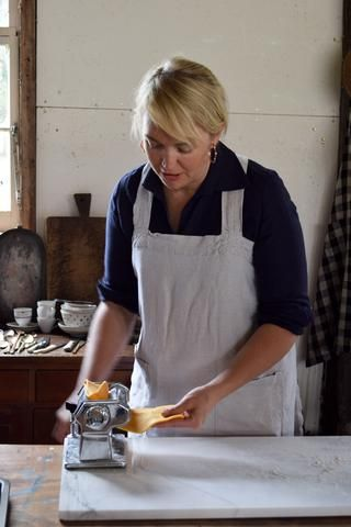 Sophie Hansen wears a linen apron at a Local is Lovely Pracshop.