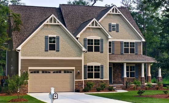 Savvy Homes craftsman style home with stone accents. Blue shutters give the finishing touch!