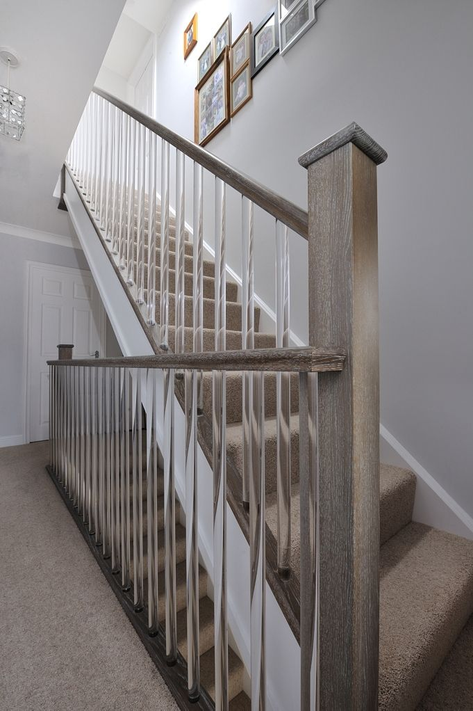 We were given a very specific challenge by The Ramsden Family. We had to match our solid oak newels, hand rails and base rails to the existing laminate floor! Also to make it more bespoke, a new style of clear spindle had to be sourced! The end result is very unique and bright, don't you agree?
