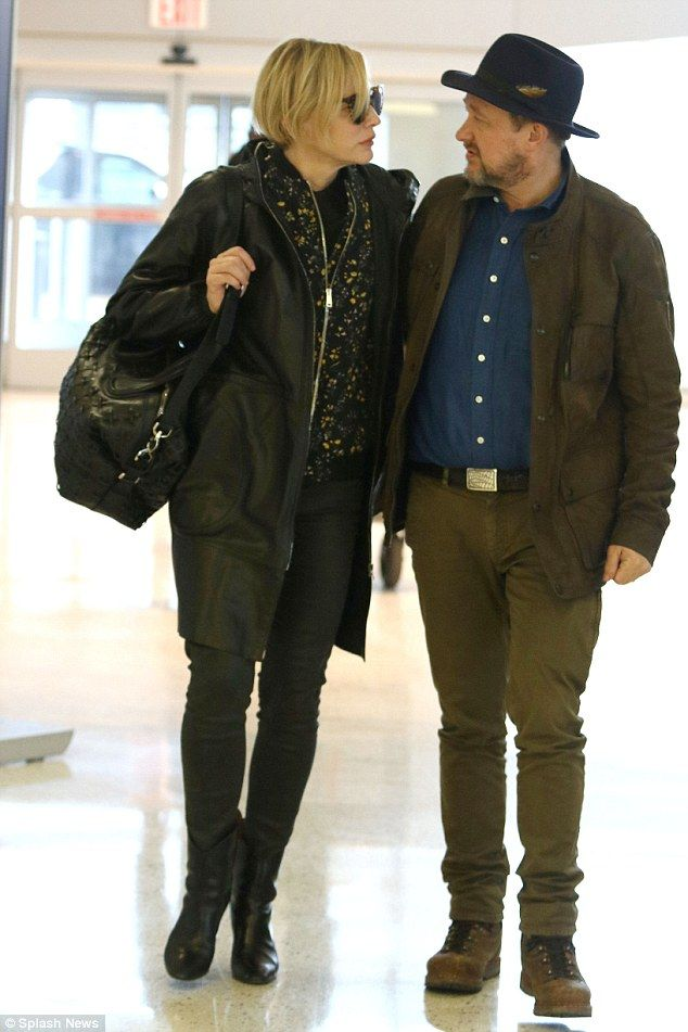 Two decades of love: Cate Blanchett, 47, and Andrew Upton, 51, looked like loved-up newlyweds as they strolled through New York City's JFK Airport hand-in-hand on Tuesday