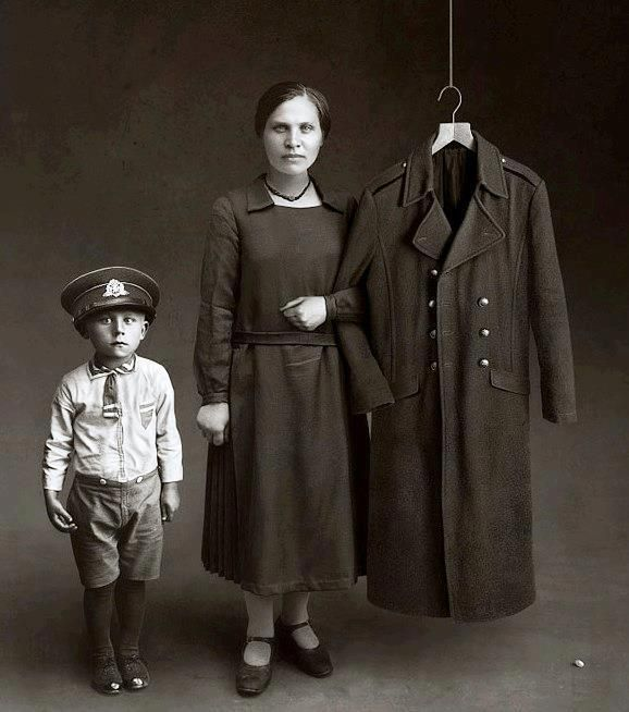This memento mori photo contains not a single deceased person, yet it feels more powerful than many of the post mortem images   The stark simplicity is breathtaking. And that little boy's determined face, wearing his father's uniform cap