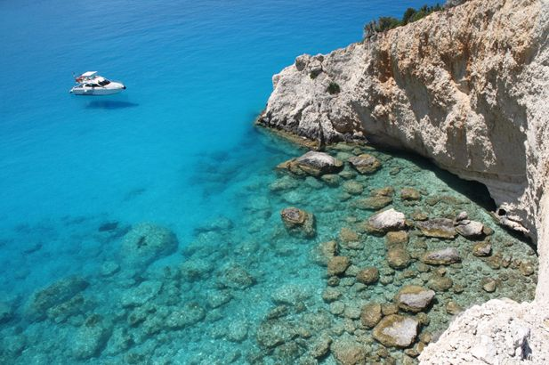 Lefkada has a wild western, cliff-girt coast with the sea rolling in from Italy across the water, lined with huge stretches of long, sandy beaches now accessible by car. The east coast borders the narrow channel to the mainland and fronts gentle green hills indented with small pebbly coves and calm green water. #FiveStarGreece #LuxuryVillas #HolidayMatchmakers