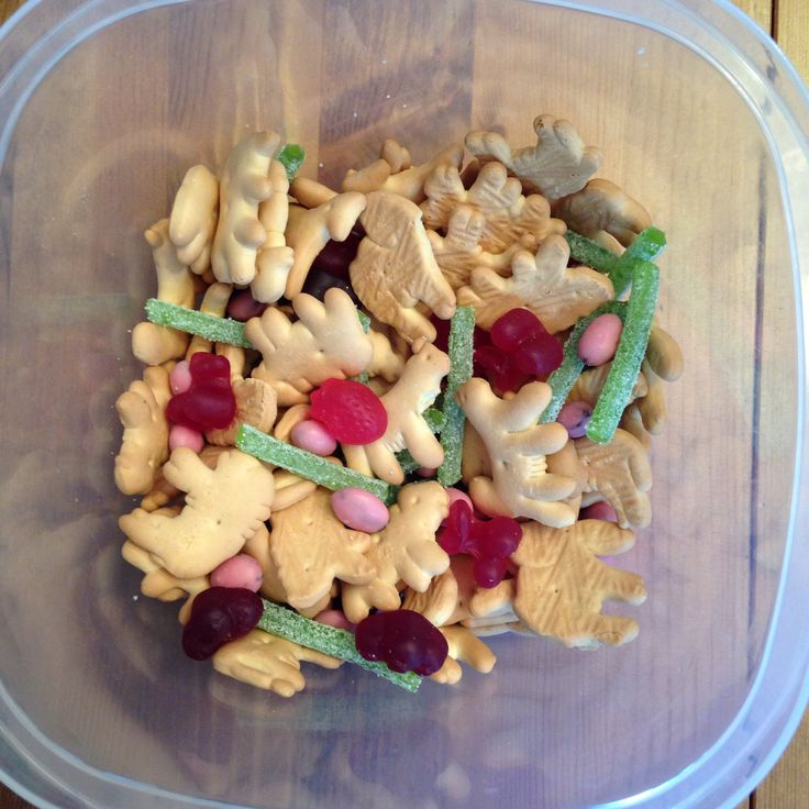 Jungle Snack Mix - animal crackers, strawberry yogurt raisins, fruit shaped fruit snacks and green sour punch straws (vines) - The Jungle Book Movie Night - Disney Movie Night - Family Movie Night