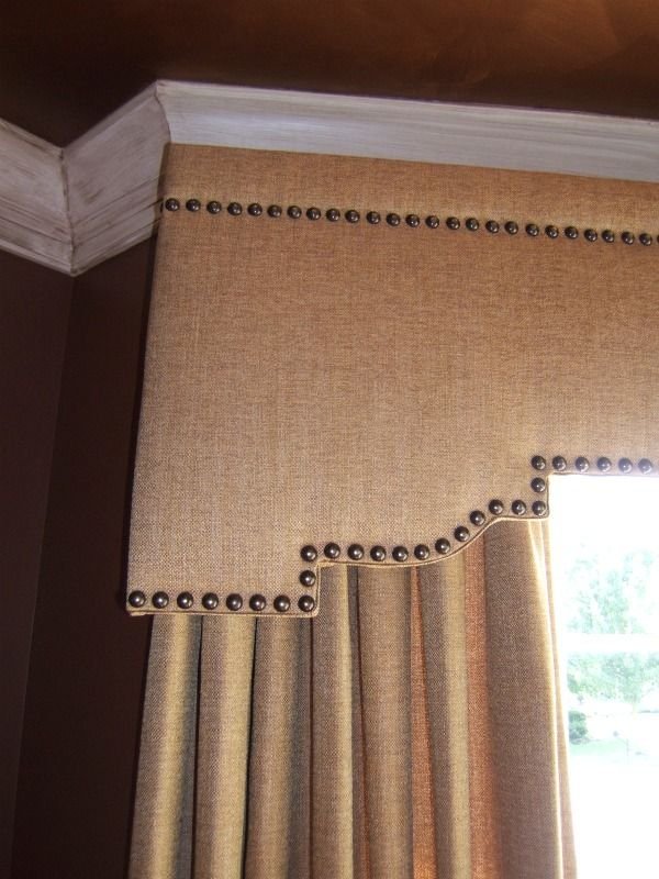 Shaped cornice with nailhead details www.drapery-design.com