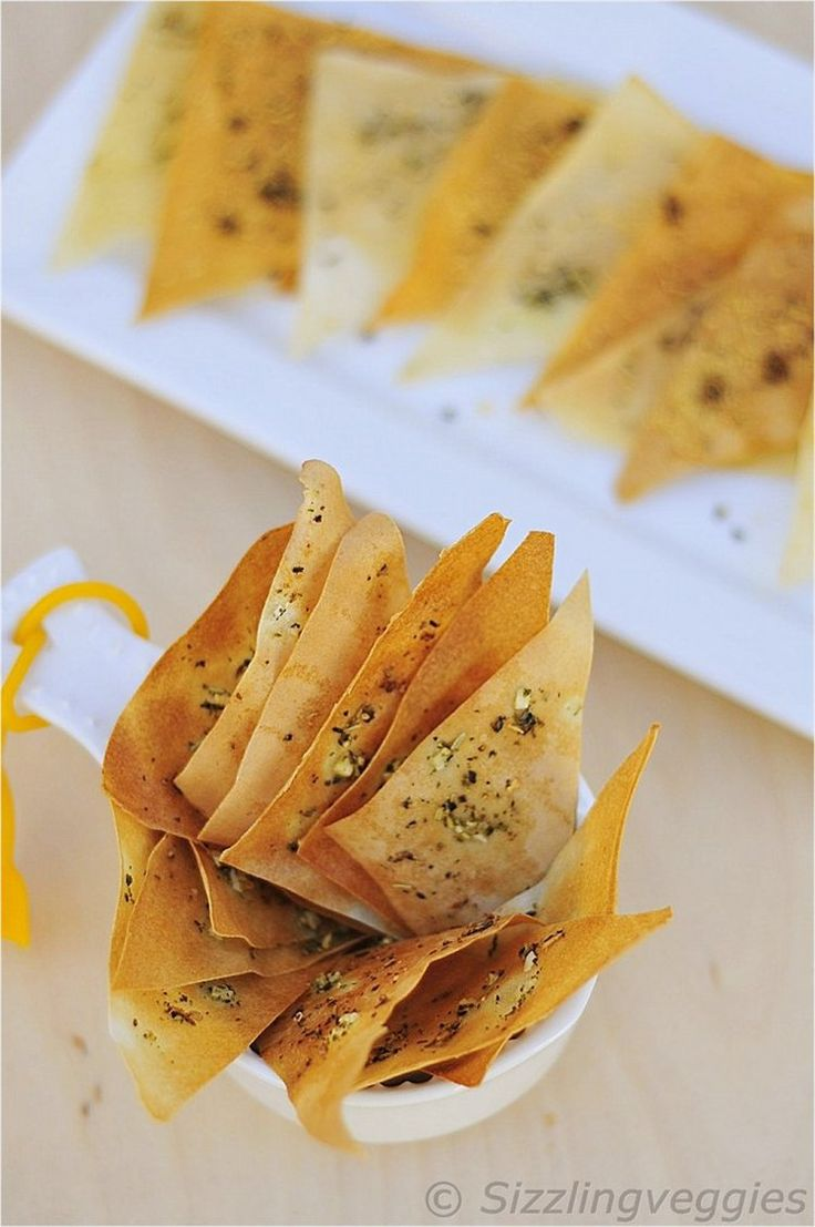 Wonton Wrappers/Spring Roll Pastry Sheet Chips flavored with Garlic and Italian Herbs.