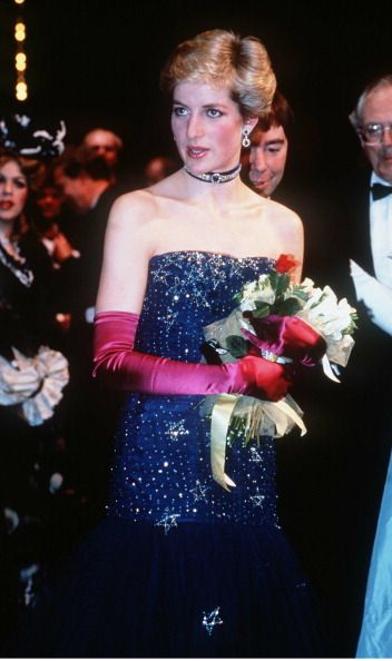 Princess Diana, wearing a navy blue Murray Arbeid dress and shocking pink long gloves, attends 'Phantom of the Opera' on February 1, 1987 in London, England.