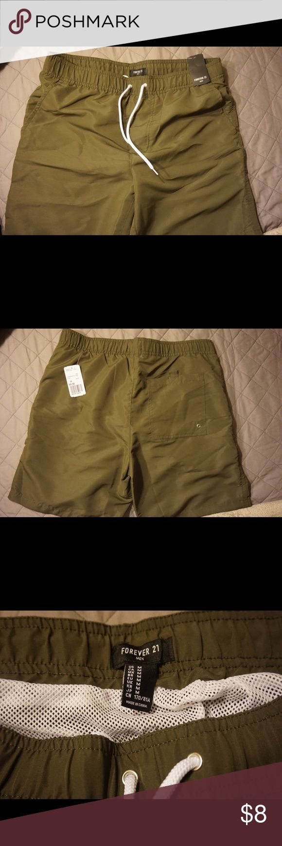 Olive green Swim Shorts Forever 21 Olive Green swim shorts , brand new never worn , were given to me as a gift , perfect condition 21men Shorts