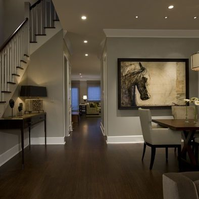 Love the color of the walls with the larger base board & crown molding in white with the dark wood floors