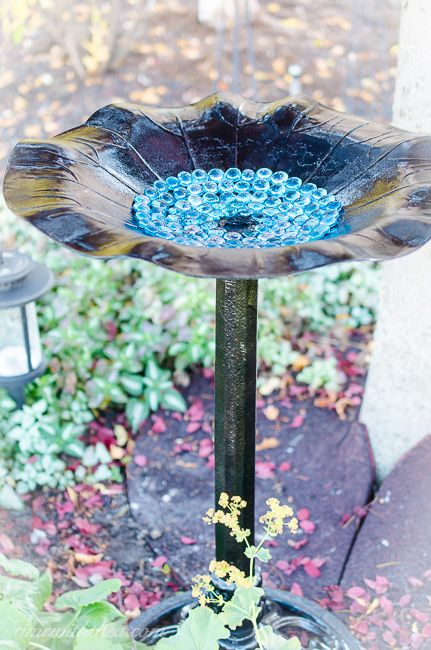 How an ugly bird bath became a restyled outdoor plant styled using black gloss spray paint and turquoise glass gems / timewiththea.com