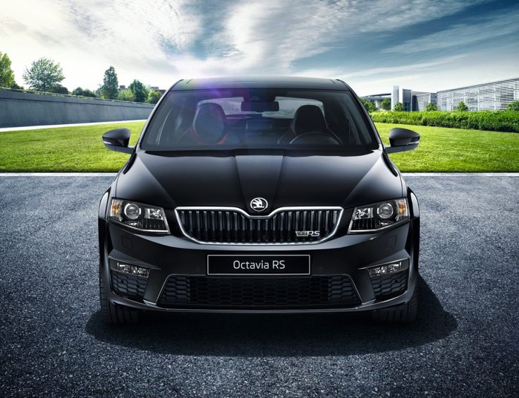 The front of the car is dominated by the characteristic ŠKODA front grille sporting the vRS badge.