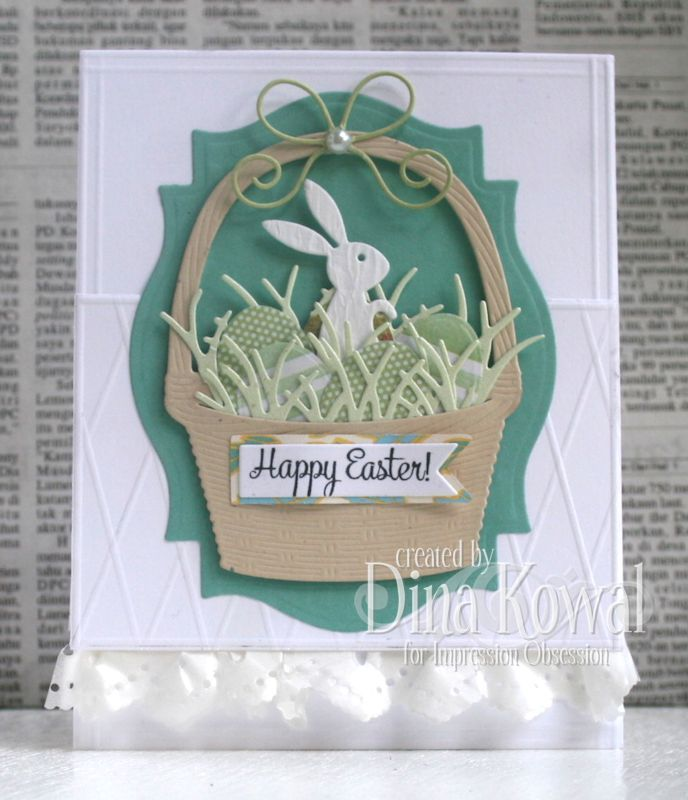 By Dina Kowal. Easter card. Bunny die-cut, basket die-cut, egg die-cut, grass die, sentiment on flag die-cut on designer paper flag. Background for basket is also a die-cut. All dies from Obsession Impression. Note the scoring.
