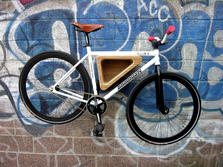 The Bedford Ave Bike Rack by 718 is a triangular bike storage solution made from birch ply and veneer