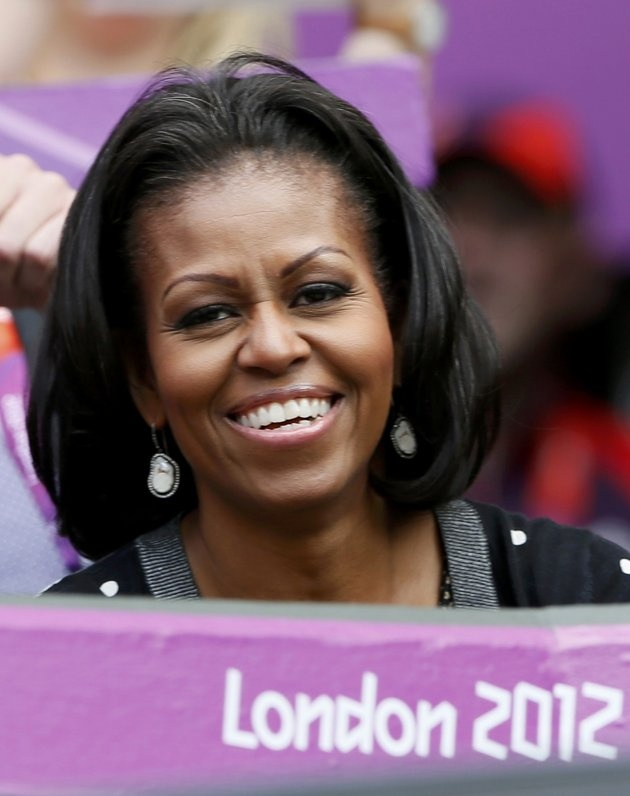 First lady Michelle Obama of the United States watches the women's singles tennis match between Serena Williams of the U.S. and Jelena Jankovic of Serbia at the All England Lawn Tennis Club during the London 2012 Olympics Games July 28, 2012.