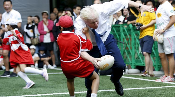 Boris Johnson rugby tackles Japanese schoolboy (VIDEO)  London's Mayor Boris Johnson collides with 10-year-old Toki Sekiguchi during a game of Street Rugby with a group of Tokyo children, outside the Tokyo Square Gardens building October 15, 2015. © Issei Kato