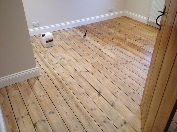 Second coat of waterborne varnish on victorian floorboards.