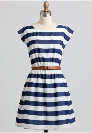 A classic nautical-inspired staple, this navy and white dress features a  striped pattern and an elastic waistband for a defined silhouette.