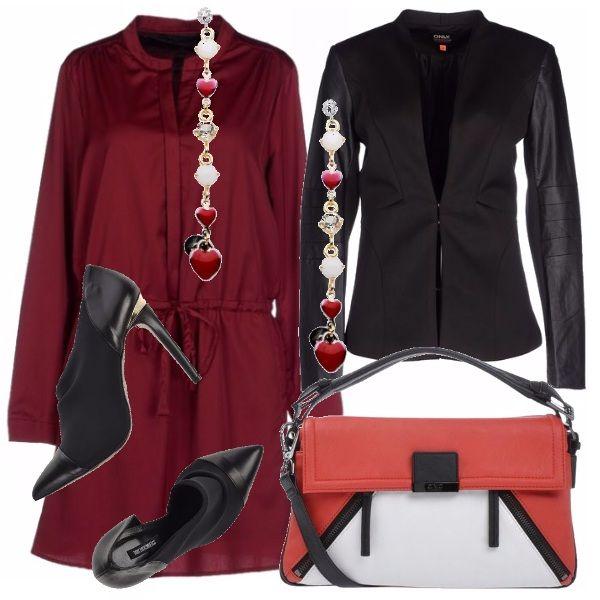 Abito corto red, effetto camicia con giacca nera con maniche in similpelle: un design che si abbina a quello del décolleté. La borsa a mano dà luminosità con il suo alternarsi di rosso, bianco e le rifiniture nere. Una cascata di cuori e punti luce per gli orecchini pendenti.