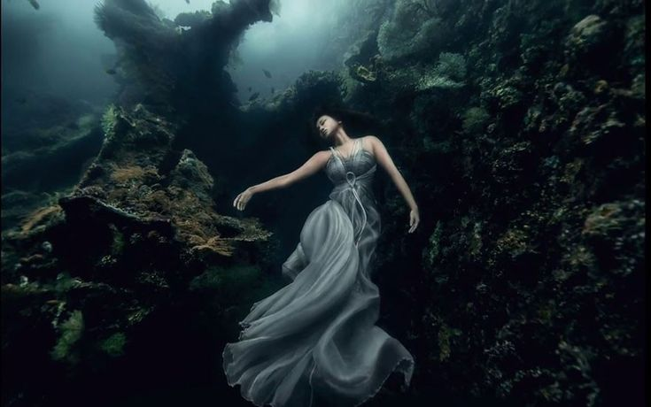 Photographer Ben Von Wong embarked on a dangerous shoot 75 feet underwater. He and a group of scubadiving models submerged descended next to a sunken ship off the coast of Bali, Indonesia. Wearing only white dresses and no suits, the brave women were roped to the wreckage and held their breath for 4 minutes as the photos were taken.