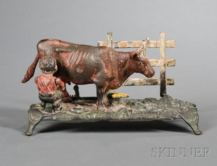 Painted Cast Iron Kicking Milk Cow Mechanical Bank, America, late 19th century, (paint losses), ht. 5 1/4, lg. 9 1/2 in.   Sold for $ 326