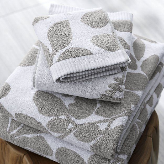 Shop Marimekko Kukkula Grey Hand Towel.  This graphic botanical print by Fujiwo Ishimoto scatters realistic silhouettes in white on light grey.  Jacquard woven of yarn-dyed cotton, the pattern reverses colors on the opposite side.