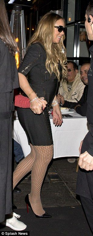 PICTURE EXCLUSIVE: Mariah Carey eats pizza with her backing dancer