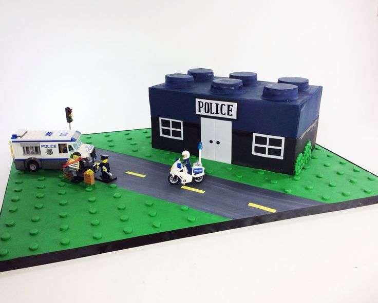 Lego cake for police officer- real Legos to complete the look.  Sweet Traders