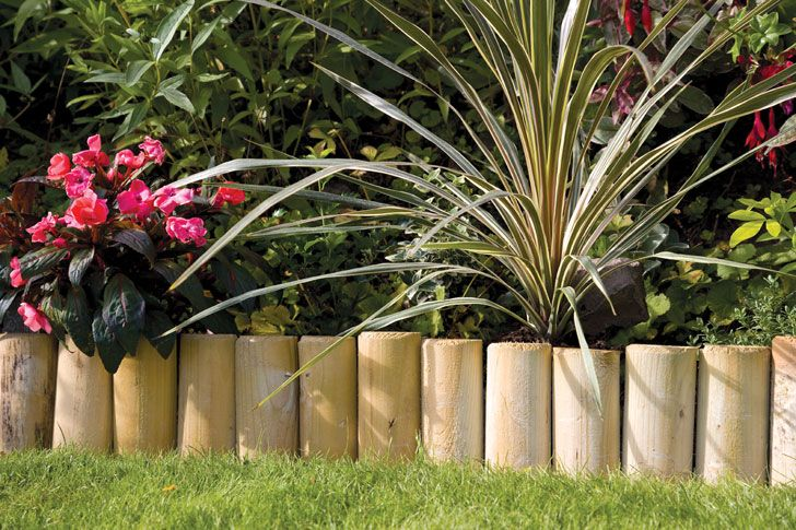 edge the planter boxes in cut log edging to prevent sprawl