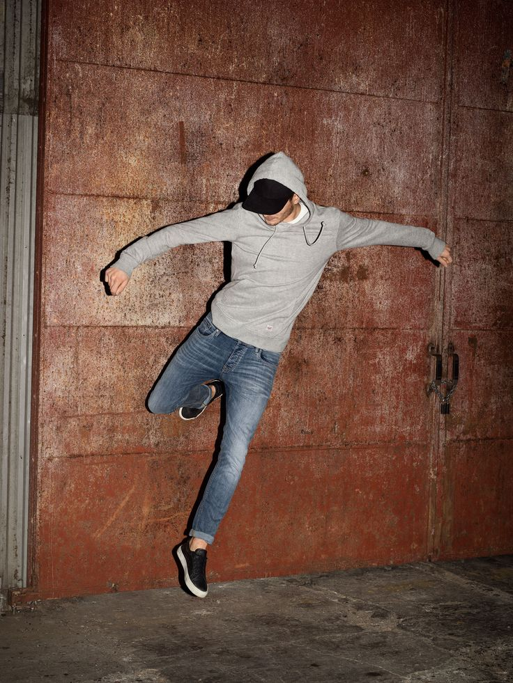 Style your blue denim super stretch jeans with a grey hoodie and black sneaks for a casual urban look | JACK & JONES