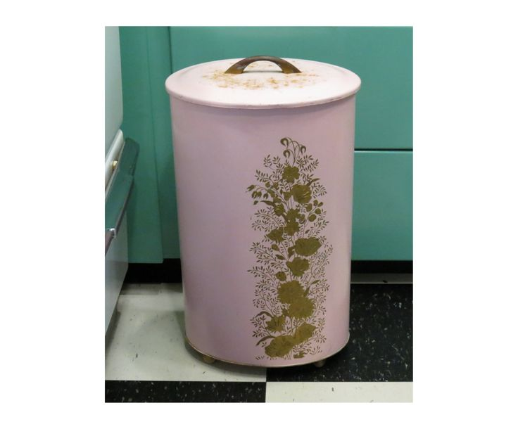 Ransburg Oval Metal Laundry Hamper With Lid . Vintage Circa 1950s . Pink With Gold Flowers . Mid Century Metalware by 13thStreetEmporium on Etsy https://www.etsy.com/listing/251520143/ransburg-oval-metal-laundry-hamper-with