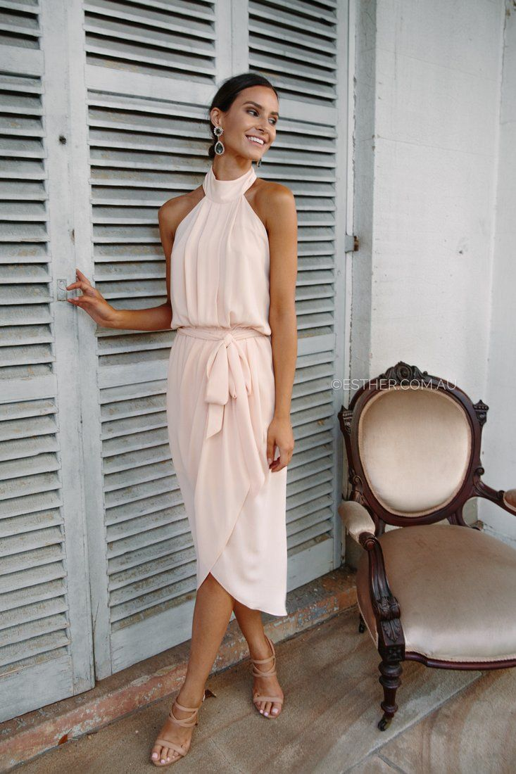 The Amaryllis Dress in Soft Peach is a dream. With halter neck, low back and waist tie details this dress suits every woman. A split skirt allows room to movewith added rouching inspired by the hourglass figure. This dress is forthose attendinga wedding or in the wedding, our soft peach colour isromantic and chic perfect for someone'sspecial day. fit: standard sizing, slightly fitted style, light weight fabric, lined, non stretch fabric, elastic waist band, high neckline, pleats in…